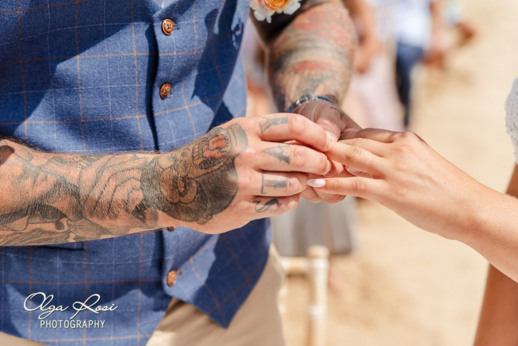Exchanging rings and pronouncing the vows on Algarve beach wedding, Lagos, Portugal by Olga Rosi Photography