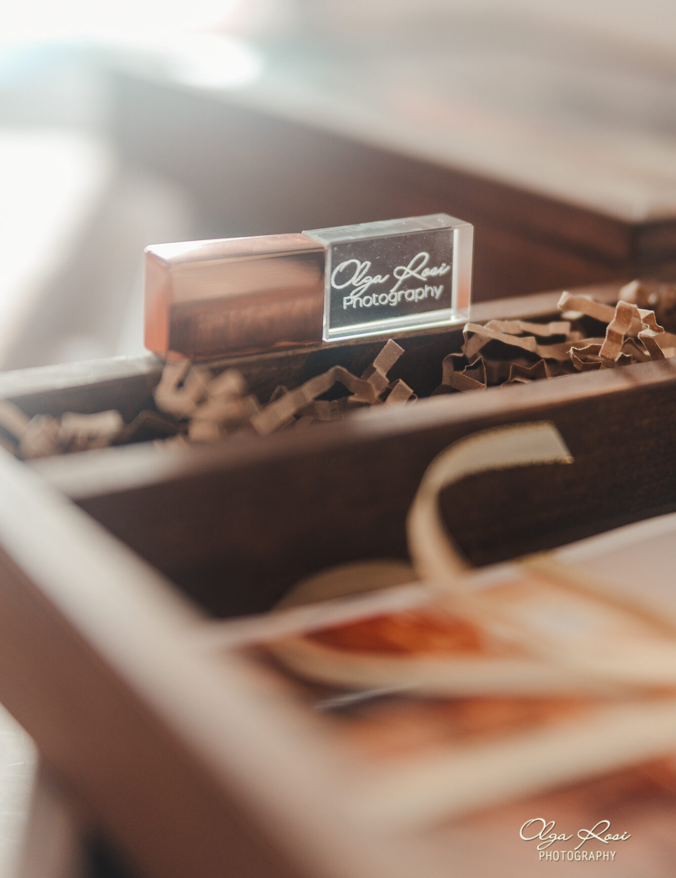 Photography delivery on USB drive with Olga Rosi Photography logo